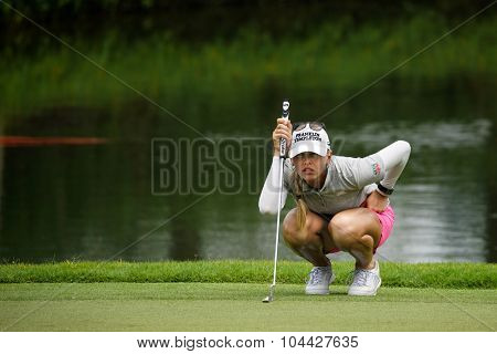 KUALA LUMPUR, MALAYSIA - OCTOBER 10, 2015: USA's Jessica Korda lines her putt at the green of the 18th hole of the KL Golf & Country Club during the 2015 Sime Darby LPGA Malaysia golf tournament.