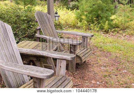 Adirondack chairs in a park in summer