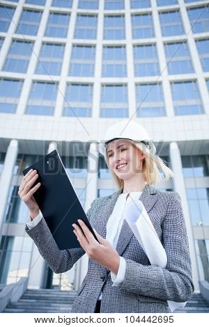 Attractive female engineer is working on new project