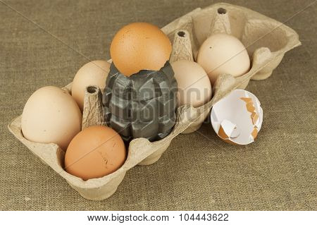 Hand grenade - an egg. Grenade between eggs. Explosive eggs, funny picture.