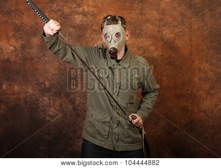 Man with gas mask and katana sword on brown batik background poster