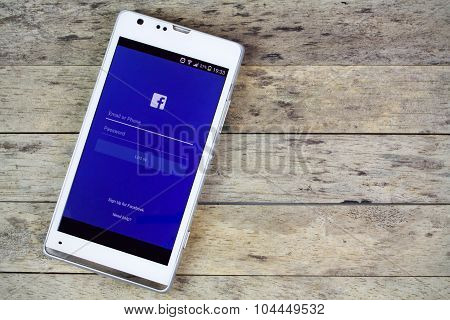 Bung Kan, Thailand - September 02, 2015: Smartphone On The Table And Facebook On Screen