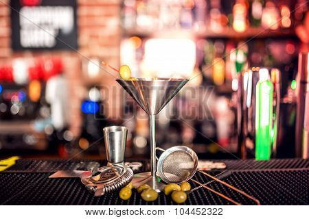 Alcoholic Drink On Bar Counter. Dry Martini With Ice And Olives, Served Cold In Restaurant, Bar