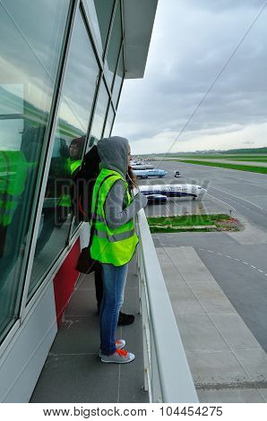 Spotting Fans Take  Picture Of Planes On The Territory Of Pulkovo International Airport In Saint-pet