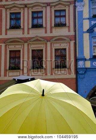Yellow Umbrella And Colorful Walls At Male Namesti