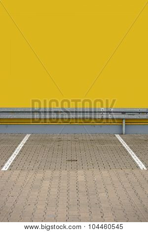 Parking lot with guardrail