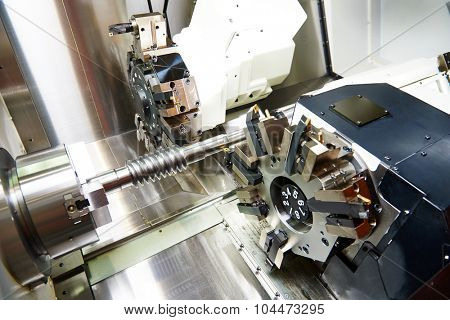 metalworking  industry: cutting tool processing steel metal shaft on lathe machine in workshop poster