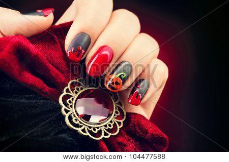 Halloween Nail art design. Nail Polish. Beauty hands. Trendy Stylish Colorful Nails and Nailpolish. Black matte nailpolish with blood drips and pumphin