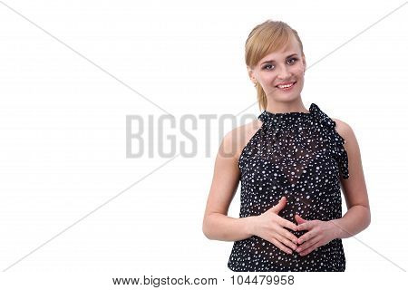 Portrait of an attractive young woman standing with crossed arms