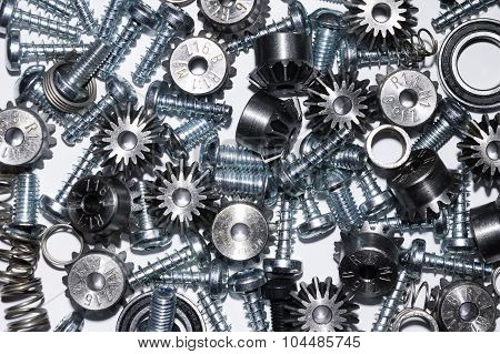 A background with different mechanical components gears springs screws industrial objects poster