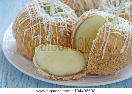 Caramel apple covered with white chocolate