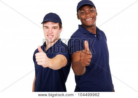 two blue collar co-workers giving thumbs up