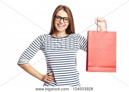 Happy female with red paperbag looking at camera