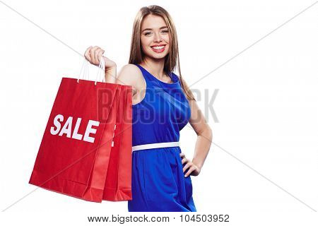 Elegant female in blue dress holding two paperbags