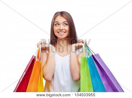 Female shopper with several paperbags after shopping