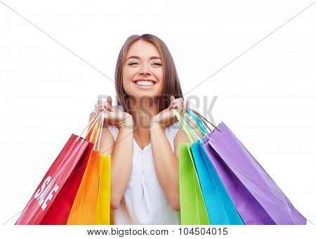 Joyful customer with several paperbags