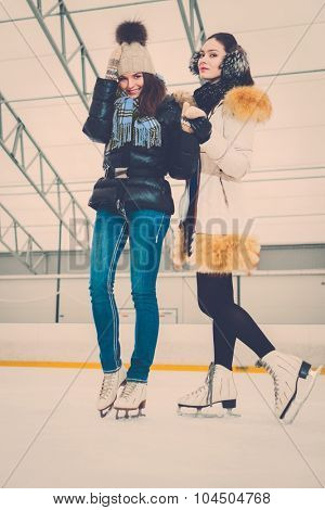Two girls on ice-skating rink  poster