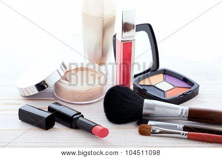 Cosmetics make-up on white wooden. background. Mock up.
