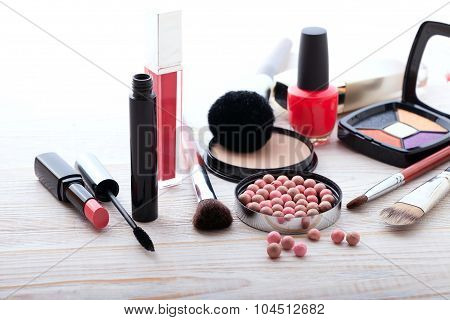 Makeup cosmetics products on white wooden background with copy space. Cosmetics make up artist objects: lipstick, eye shadows, eyeliner, concealer, nail polish, powder, tools for make-up poster