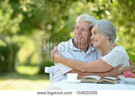 Happy old couple with drink
