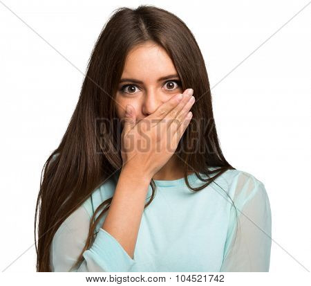 Scared young woman with her hand closing her mouth