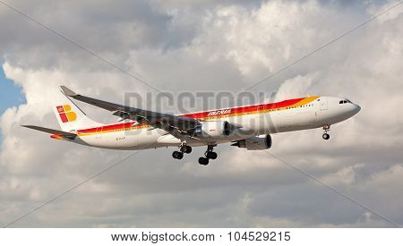 MIAMI, USA - March 24, 2015: An Iberia Airbus 330-300 landing at Miami International Airport.