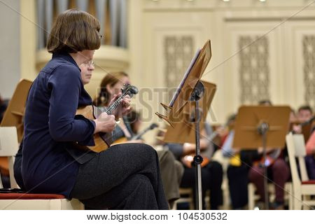 ST. PETERSBURG, RUSSIA - OCTOBER 6, 2015: Musicians of the Andreyev State Russian Orchestra on the rehearsal with Star Sopranos of China in the Philharmonic Hall during the Festival of Chinese music