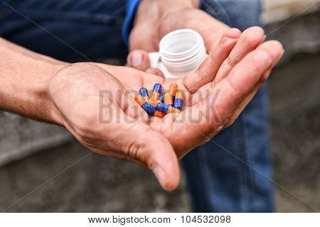 Depressed Teenage Boy With Many Tablets In Hand, Wants To Take An Overdose. Concept Of Loneliness, M