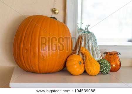 Pumpkin and gourds on the mantel