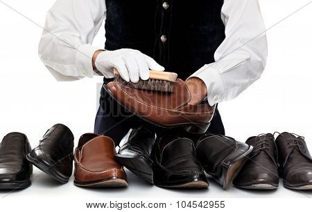Concept of a butler or servant man polishing leather shoes poster