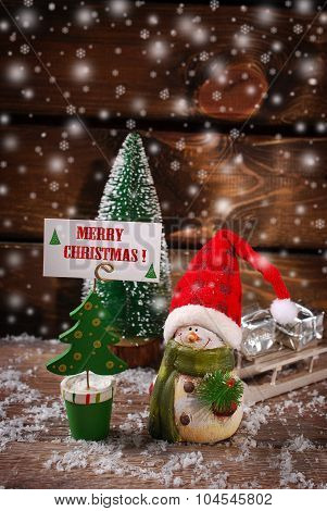 Christmas  Decoration With Snow On Wooden Background