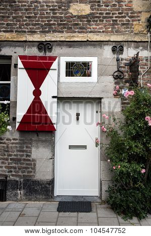 Front door with red & white shutters on a medieval house