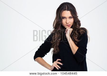 Portrait of a lovely girl biting her lips and looking at camera isolated on a white backgrund