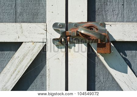 Tool Shed Door With Rusty Lock