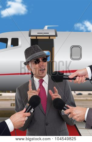 Businessman standing in front of corporate jet