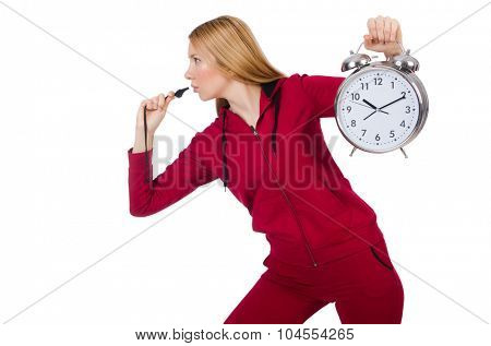 Pretty coach holding alarm clock isolated on white