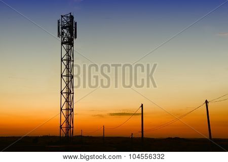 gsm tower and old telephone pylons