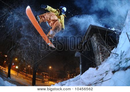Jumping snowboarder in the city