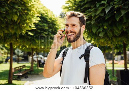 Student With Backpack Talking At Cellphone