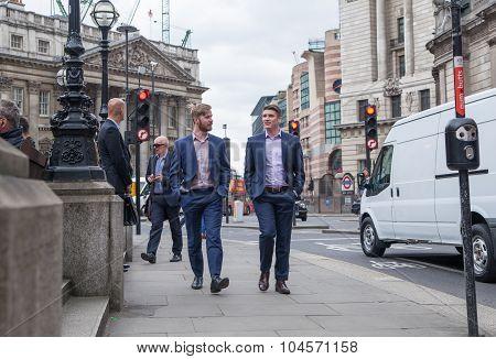 LONDON, UK - APRIL 22, 2015: business people walking Bank of England street