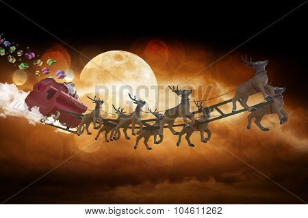 Santa Claus riding a sleigh led by reindeers on blue stars