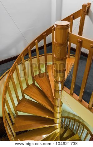 Spiral Wooden Staircase With Varnished Balusters