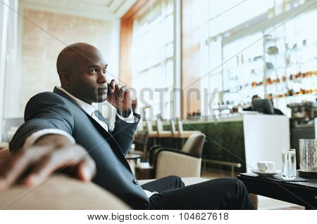 African Business Man Waiting In A Hotel Lobby