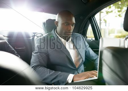 Businessman Working Inside The Car While Travelling
