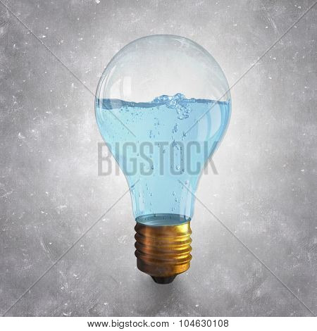 Glass light bulb with clear blue water inside