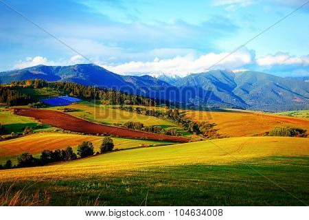 Solar power plant in the mountains on meadow. Beautiful landscape scenery