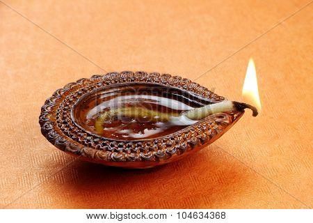 Hindu Festival Diwali Diya On Orange Background