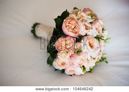 Wedding Bouquet On  White Silken Sheet