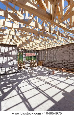 New residential wooden construction home framing. Building a roof with wooden balks