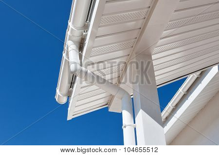 New rain gutter on a home against blue sky